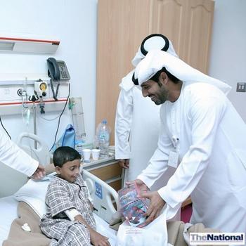 Abu Dhabi municipality officials pay sick children a visit